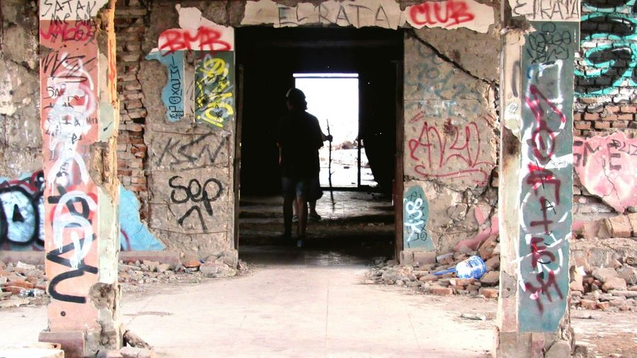 wait...? Graffiti Street Art Spray Paint Abandoned Architecture Built Structure Dirty Doorway Door Damaged Destruction Old Ruin Ghetto Rotting No People Building Exterior Day Indoors  City The Graphic City