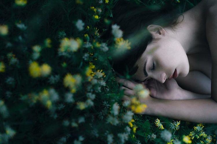 Woman looking at flower tree