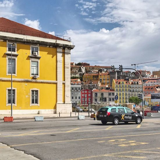 Vehicles on road against buildings in city