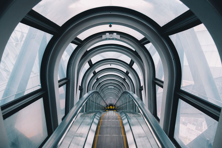 Architecture Built Structure Indoors  Glass - Material The Way Forward Arch Direction Transportation Building Modern Transparent Day Motion Escalator Travel Elevated Walkway Diminishing Perspective Pattern Window Moving Walkway  Ceiling Tunnel
