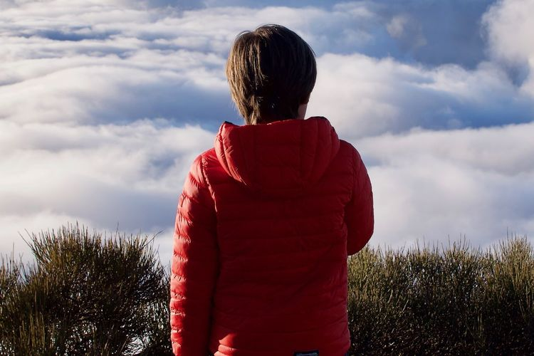 Child looking at a sea of clouds