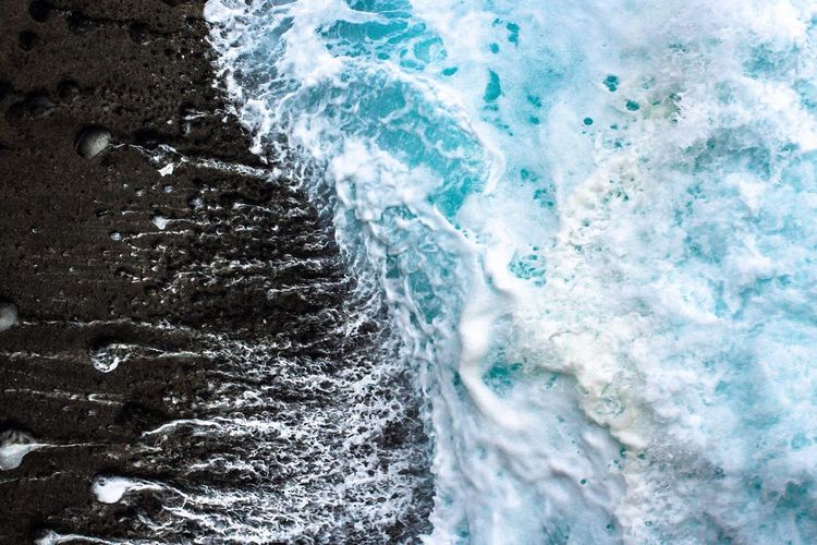 Close-up of waves splashing on sea