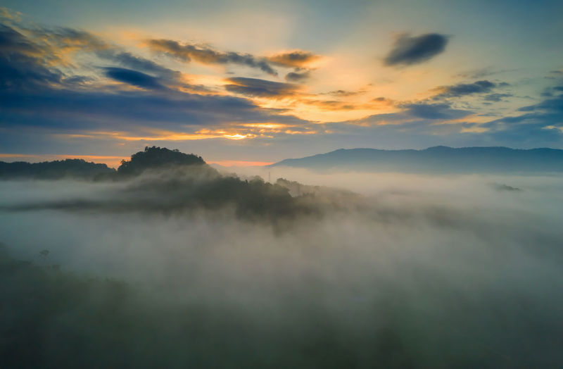 Aerial view beautiful of morning scenery sea of cloud and the fog flows on high mountains.
