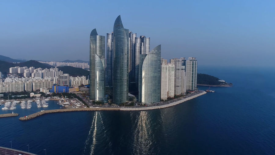 Modern buildings in city at waterfront