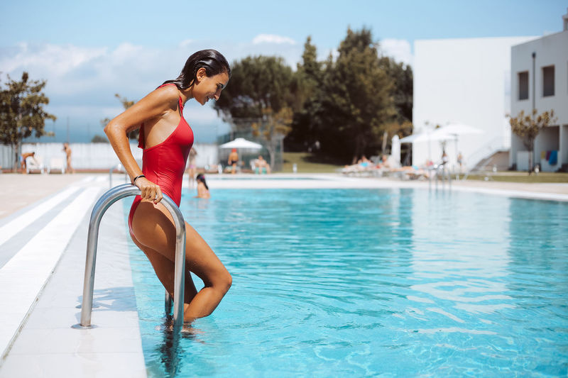 Side view of young woman in swimming pool