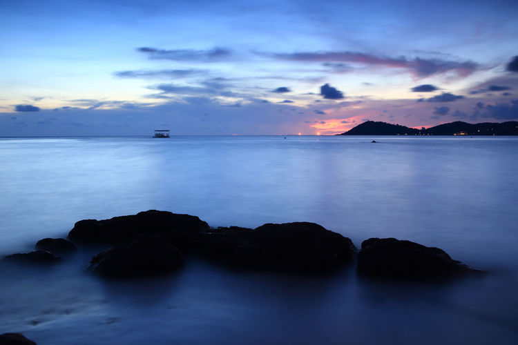 Scenic view of sea against romantic sky at dusk