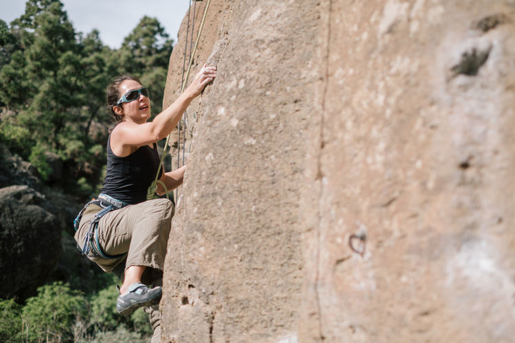Climbing in Arico / Tenerife Adventure Cliff Climbing Danger Day Extreme Sport Extreme Sports Leisure Activity Lifestyles Mid Adult Mountain Mountain Range Mountains Nature One Person Outdoors Real People RISK Rock Rock - Object Rock Climbing Skill  Strength Young Adult Young Men
