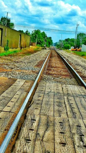 Traintrack Railroad Track Crystal Springs, Ms.usa Where I Come From Tomato Capital Of The World Railroad Crossing Tracks Railroad Ties Wooden Ties Town Times Past Transportation Outdoor Photography Blue Skies Shipping Sheds Shipping Buildings Gravel Travel Shipping Terminal Types Of Travel