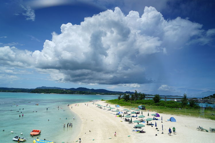 Beach Beauty In Nature Cloud - Sky Crowd Day Group Of People Holiday Land Large Group Of People Leisure Activity Nature Outdoors Real People Scenics - Nature Sea Sky Travel Trip Vacations Water
