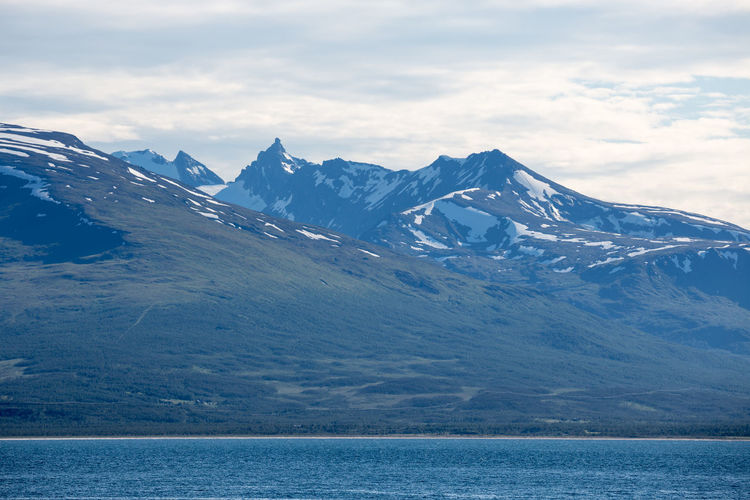 Lake By Snowcapped Mountain