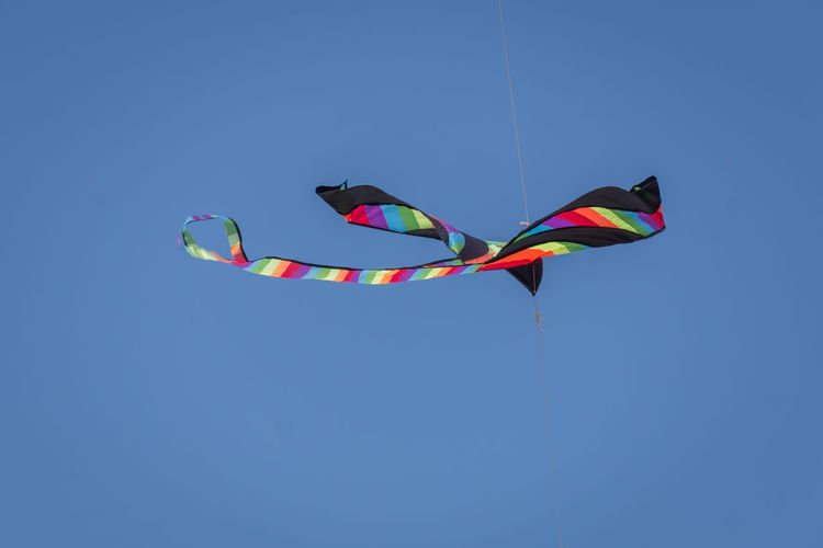 Kite Blue Clear Sky Day Flying Freedom Kite Kite - Toy Low Angle View Motion Multi Colored No People Outdoors Representation Sky Wind