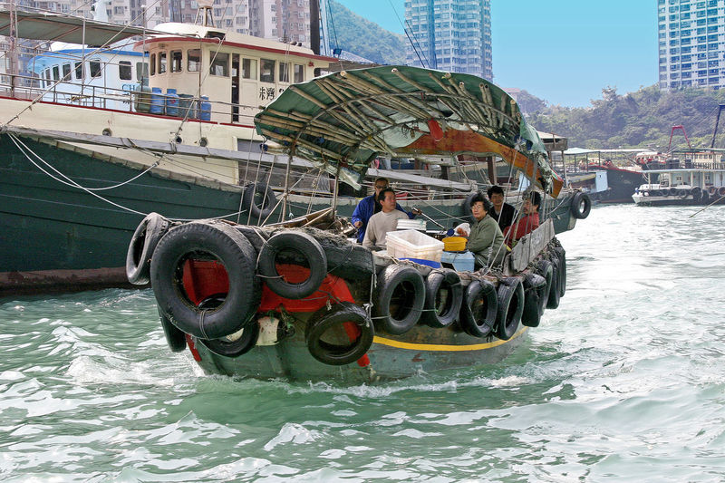 A sanpan in the Typhoon shelter - Hong Kong, China A Taste Of Hong Kong Hong Kong Airport Hong Kong City Hong Kong Typhoon Shelter Sanpan Architecture Boat Building Exterior Built Structure Day Men Mode Of Transport Moored Nature Nautical Vessel Outdoors People Real People River Transportation Water Waterfront An Eye For Travel Mobility In Mega Cities Adventures In The City The Traveler - 2018 EyeEm Awards