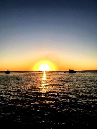 Sunset Punta del este - Uruguay Puntadeleste Solanas Summertime Summer Sea Beauty In Nature Tourism Tranquility Water Nature Sun Horizon Over Water Reflection Travel Destinations Sunlight Scenics Tranquil Scene Nautical Vessel Vacations Outdoors No People View Into Land Sky First Eyeem Photo