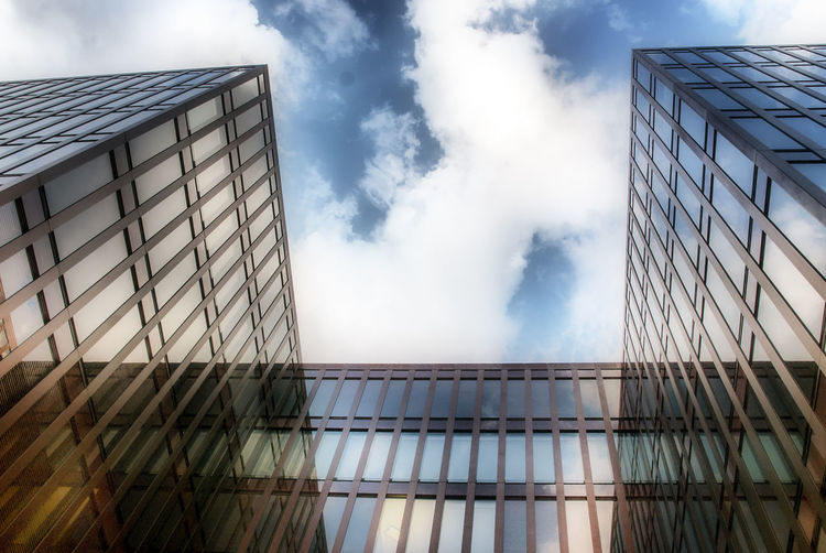 Modern architecture in Hafen City Hamburg Architecture Building Building Exterior Cloud Cloud - Sky Cloudy Day Development Engineering Exterior Low Angle View Modern No People Office Building Outdoors Power In Nature Sky Smoke Structure