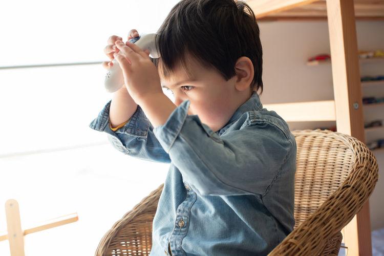 Boy looking at camera at home