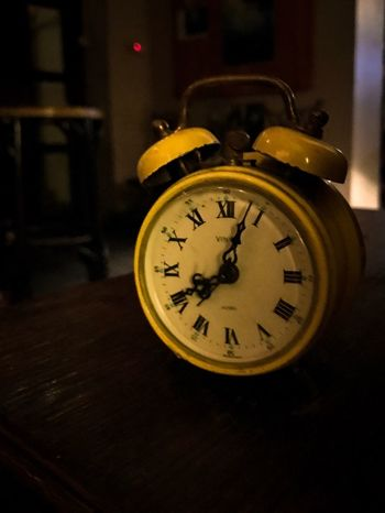 Time Clock Indoors  Focus On Foreground Old-fashioned Alarm Clock No People Table Home Interior Night Clock Face Minute Hand