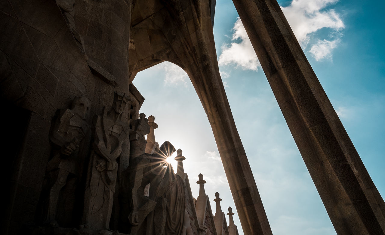 sky, low angle view, architecture, built structure, history, the past, cloud - sky, nature, sculpture, no people, art and craft, day, ancient, travel destinations, representation, architectural column, travel, sunbeam, statue, tourism, sun, ancient civilization, lens flare, ruined