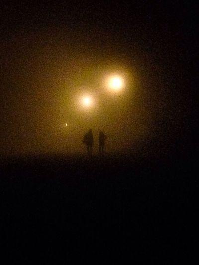 People walking in the fog. Weather