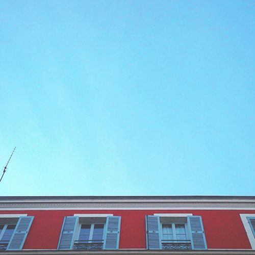 Beautifully Organized Blue Red Building Exterior Architecture Clear Sky Day Windows IPhoneography