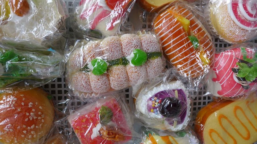 Full frame shot of various food wrapped in plastic