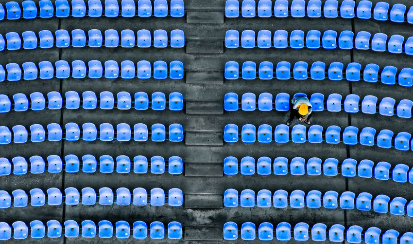 High angle view of man sitting on chair in stadium