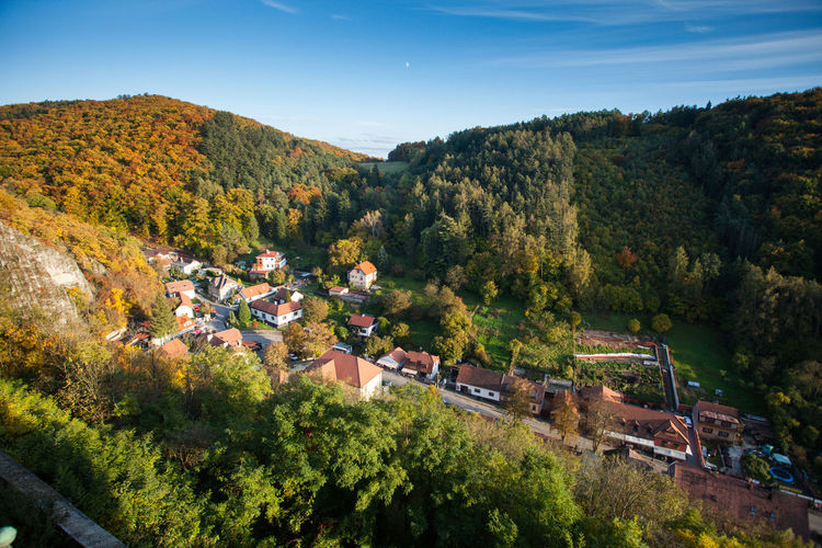 Village in the middle of the forest, natural landscape Architecture Autumn Beauty In Nature Day Forest Growth Hills Houses Lush - Description Mountain Nature No People Outdoors Sky Tree Village