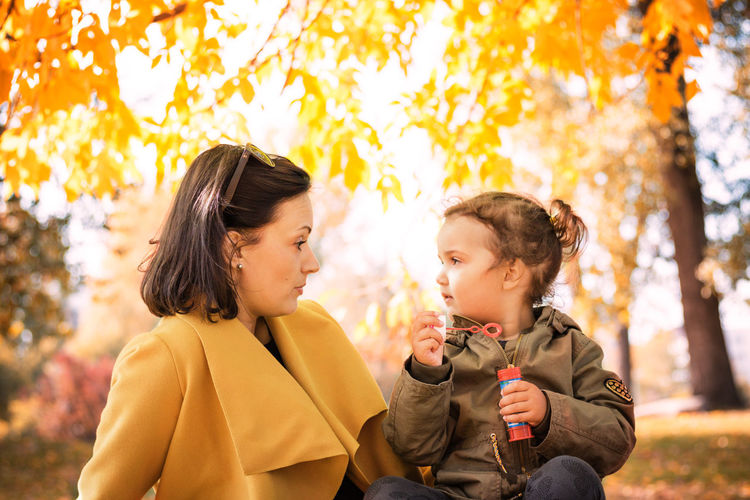 Woman with daughter at public park