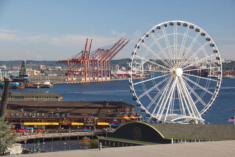 High angle view of seattle ferris wheel above elliott bay barbour against blue sky