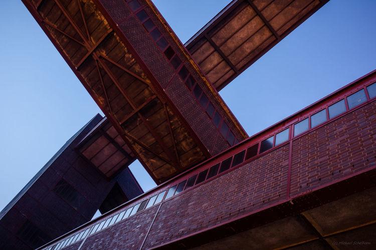 Low angle view of bridge against sky, zeche zollverein
