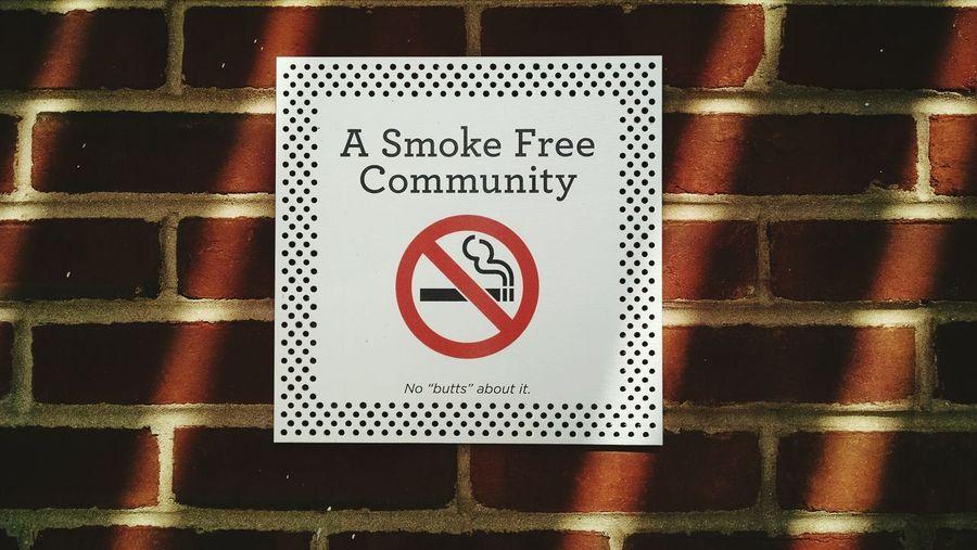 Communication Text Symbol No People Day No Smoking Signs Sign Sun Shadow Brick Wall