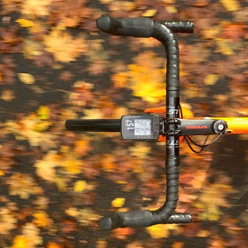 Close-up of bicycle on street during autumn
