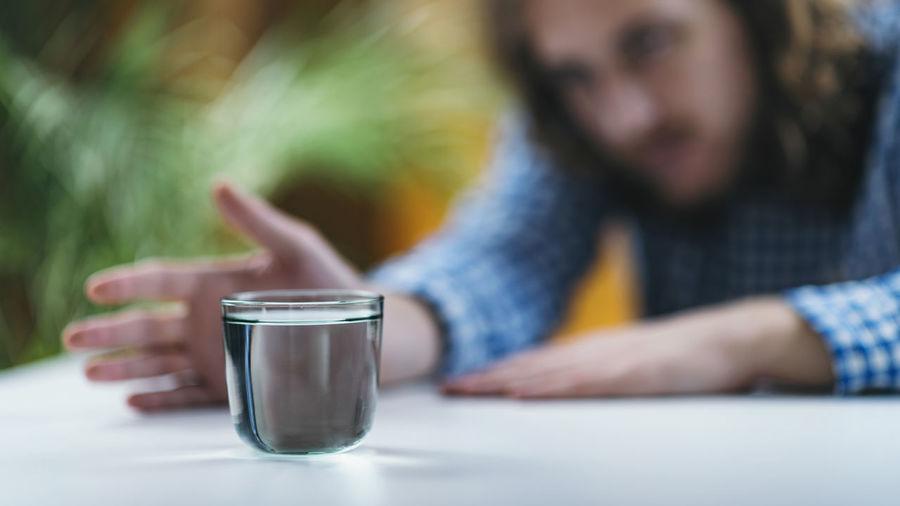 Telekinesis. practicing telekinetic powers with glass of water