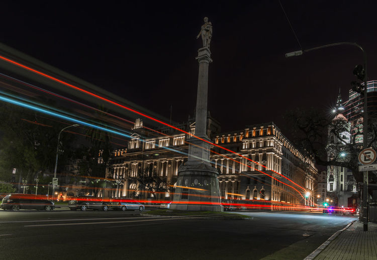 Light trails on road by supreme court of argentina at night