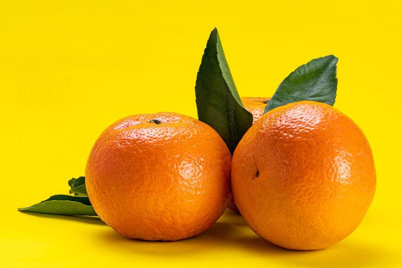 Close-up of oranges against orange background