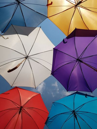 Multi Colored Backgrounds Full Frame Blue City Sky Close-up Umbrella Parasol Composition Sun Lounger Under