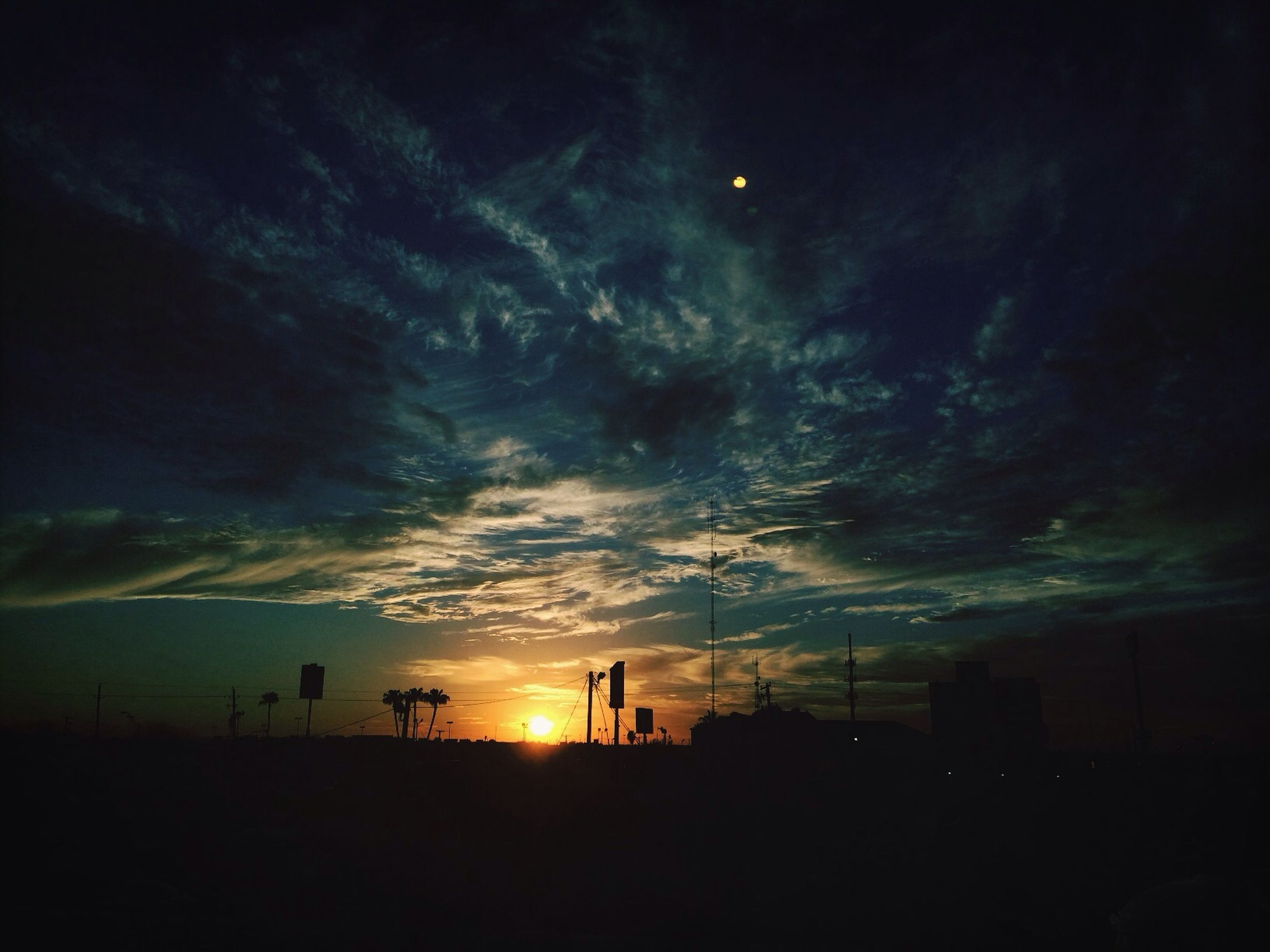 silhouette, sky, sunset, scenics, tranquil scene, beauty in nature, tranquility, cloud - sky, nature, landscape, dark, idyllic, dusk, dramatic sky, cloudy, weather, cloud, outdoors, atmospheric mood, storm cloud