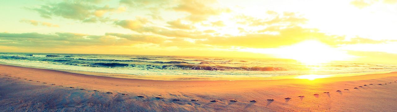 sunset, beauty in nature, scenics, nature, sea, sand, tranquil scene, tranquility, beach, sky, horizon over water, outdoors, idyllic, sun, cloud - sky, no people, water, landscape, day