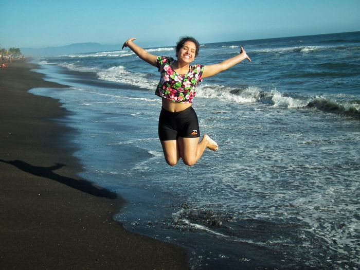 Summer vibes Jumping Beach Waves Ocean Mexico Spring Break Summer Exploratorium Water Sea Leisure Activity One Person Emotion Happiness Outdoors Nature Smiling Young Women Arms Outstretched Front View