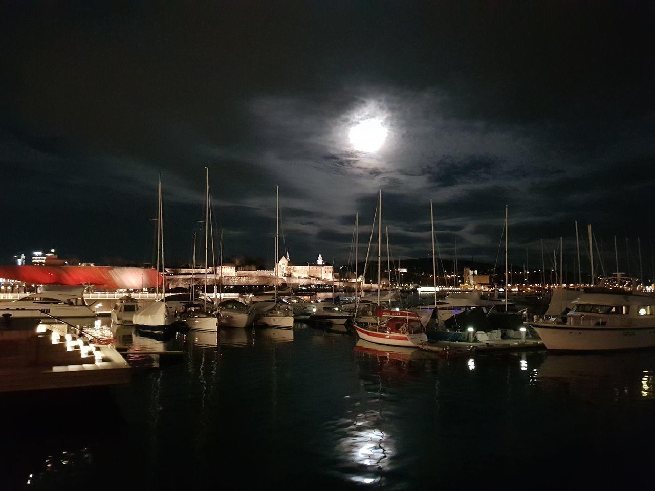 nautical vessel, transportation, water, moored, sky, mode of transportation, cloud - sky, harbor, night, sailboat, reflection, mast, illuminated, nature, sea, no people, waterfront, pole, architecture, yacht, outdoors, marina, full moon, moonlight, port