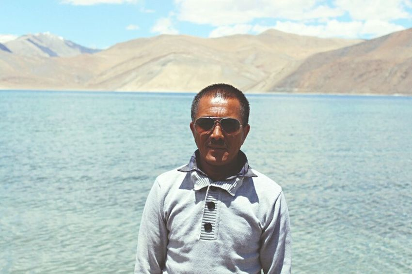 Our tour guide in Ladakh, Phunchok (his name).People Of The Oceans Mountains And Water Blue Sky Summertime Feel The Journey Mountains And Sky Landscape_Collection Nature Photography Beauty In Nature Portrait Photography Local People Travel Photography Pangonglake Incredible India Indian Man Sunny Day Leh Ladakh Portrait Jammu And Kashmir People Photography Trips Around The World Amazing View Natural Light Portrait