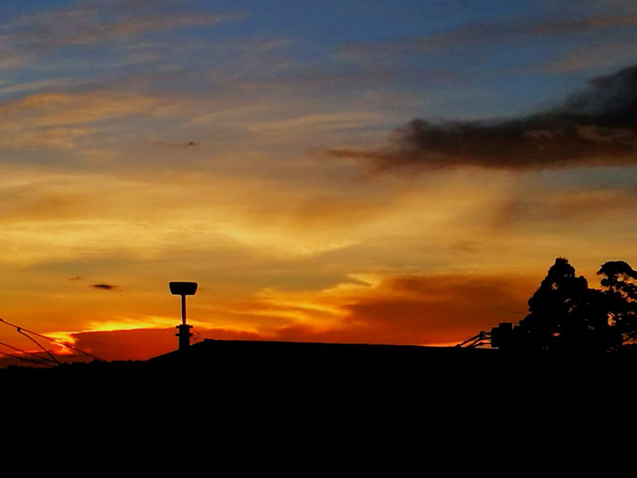 sunset, silhouette, orange color, sky, cloud - sky, nature, beauty in nature, no people, outdoors, low angle view, scenics, architecture, day