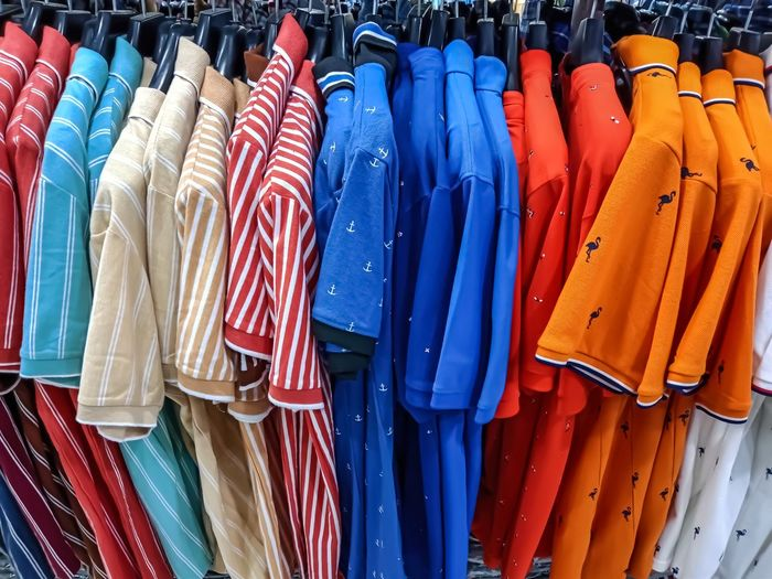 Multi colored clothes for sale in store