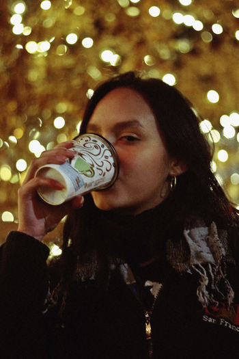 Xmas, 2018 One Person Portrait Real People Young Adult Leisure Activity Focus On Foreground Headshot Lifestyles Young Women Celebration Holding Front View Tree Smiling Illuminated Looking At Camera Looking Food And Drink Happiness Hairstyle Hot Chocolate Coffee Bokeh Christmas Holidays