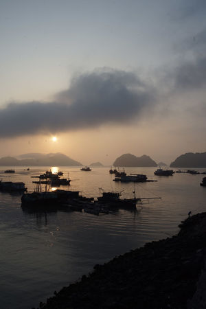 traveling Vietnam 2018 ASIA Travel Traveling Vietnam Beauty In Nature Cloud - Sky Dusk Explore Fishing Boat Fishing Industry Idyllic Mode Of Transportation Nature Nautical Vessel No People Outdoors Reflection Scenics - Nature Sea Silhouette Sky Sunset Tranquil Scene Tranquility Transportation Water