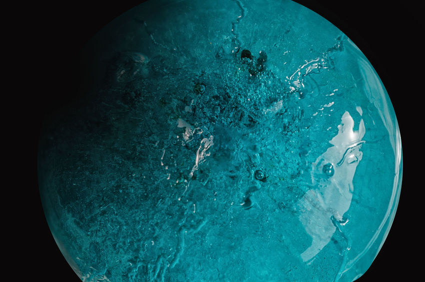Ice Black Background Blue Close-up Cold Temperature Frozen Geometric Shape Globe - Man Made Object Melting No People Single Object Sphere Studio Shot Turquoise Colored Water