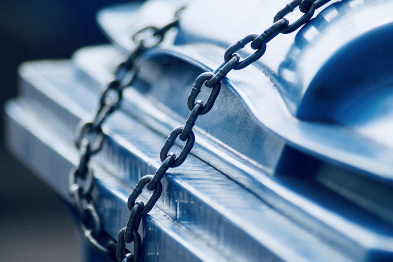 Close-up of chain tied up of metal fence