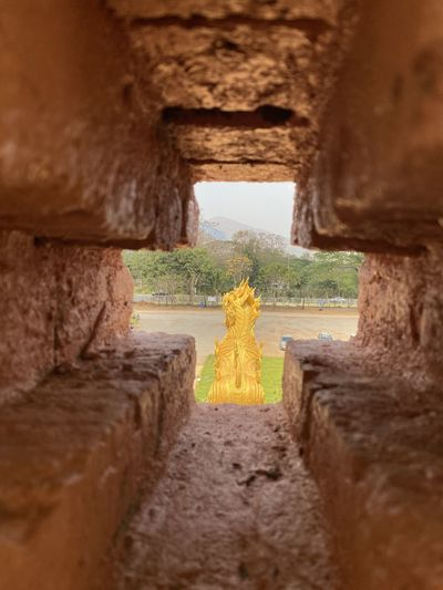 View of yellow wall through hole