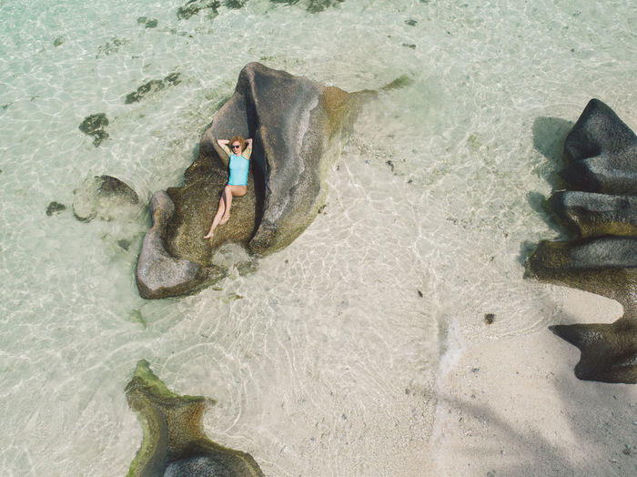 High angle view of child on beach