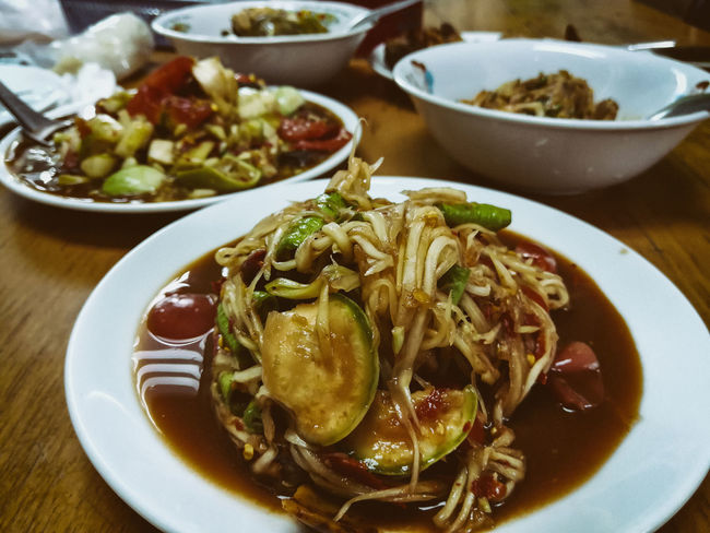ASIA Asian  Diet Hot Spicy Food Bowl Close-up Day Food Food And Drink Freshness Healthy Eating High Angle View Indoors  Meal No People Papaya Salad Plate Ready-to-eat Serving Size Table Thai Food