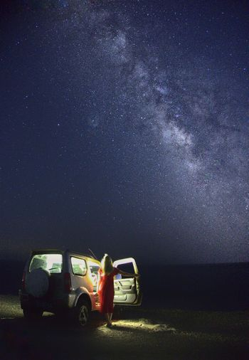 car on field at night - milkyway astrophotography